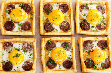 Top down perspective of savoury egg and sausage pastrytarts