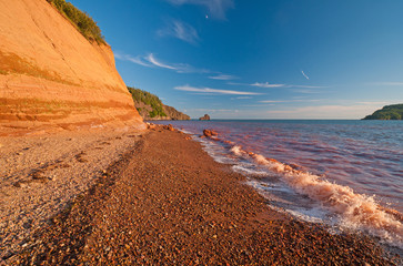 Red Waves on a Red Sandstone Beach