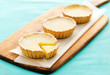 Lemon tarts on a wooden serving board