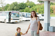 Family at bus station