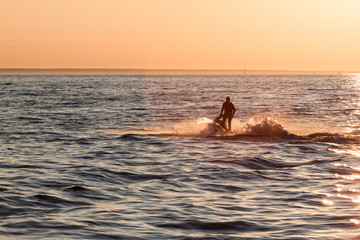 Young guy cruising in the baltic sea  on a jet ski