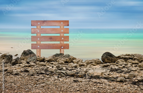 Wooden sign in seascape area