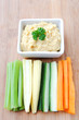 Healthy appetiser vegetable sticks with humus