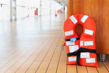 Singular life jacket stands on deck of cruise passenger liner