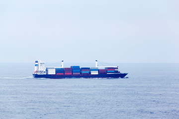 Large cargo ship floats in open ocean