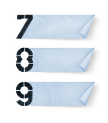 7, 8, 9, - Number paper and paper banners isolated on white back