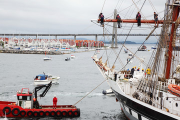 Competitors hang aloft at ship