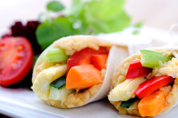 Healthy bite size wraps with carrot, capsicum and a side salad
