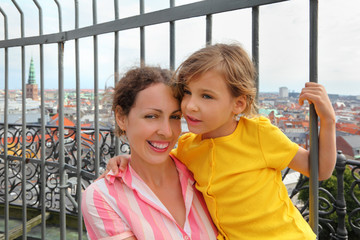 Happy mother and daughter at Rundetorn Tover in Copenhagen