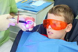 Patient boy in orange protective glasses