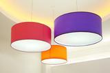 Fototapety Purple, red and orange round stylish lampshades hang