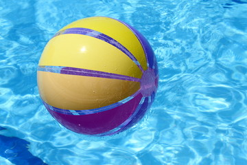 Beachball and swimmingpool.