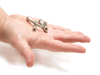 four bolts on a human hand