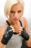 Woman ready to fight with kickbox gloves