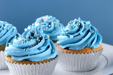 Blue cupcakes with silver decorations