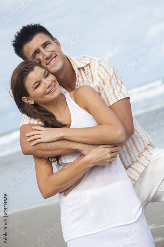Man and Woman Couple Embracing On A Beach