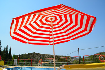 sea umbrella with red and white stripes