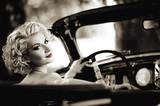 Fototapety Retro woman behind steering wheel
