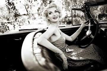 Smiling retro woman in convertible