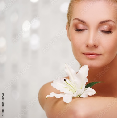 Beautiful woman with lilly flower portrait