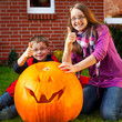 children proud of their jack-o-lantern