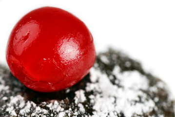 Maraschino cherry on chocolate cake