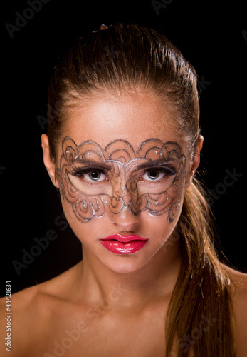 young woman with lace makeup