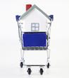 Einkaufswagen mit Haus
