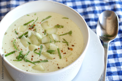 Chilled and creamy cucumber gazpacho with mint and chili flakes