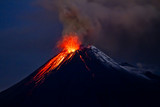 Tungurahua Volcano eruption with blue skies and lava
