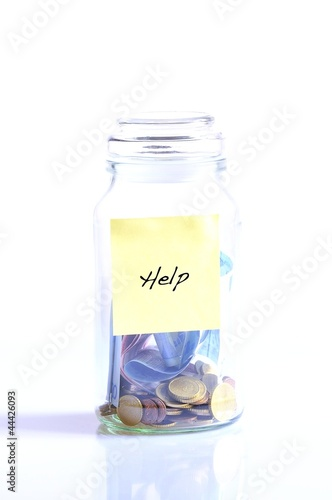 Glass jar with coins and word help.