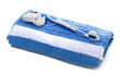 dental floss and toothbrush, towel on a white background