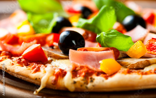 Close up of pizza with ham and vegetables