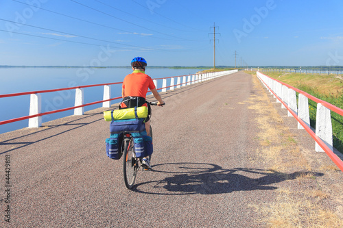 Cyclist on a causeway, road between Saaremaa and Muhu.