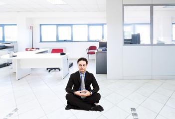 Businessman in a meditation pose