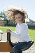 happy little girl on a playground - swing