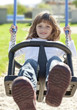 happy little girl on a swing - playground