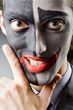 Businessman with clown face paint