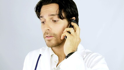 Young doctor on the phone with patient