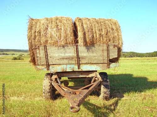 Two rolls of hay on a cart