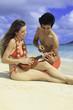polynesian man shows girl how to play ukulele