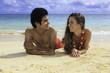 couple lounging on a hawaii beach