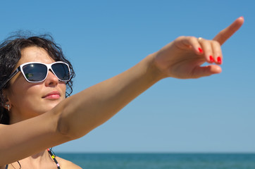 Woman in sunglasses pointing