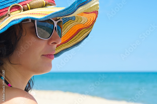 Woman wearing sunglasses and hat