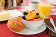 Fresh fruit with croissants