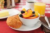 Fresh fruit with croissants