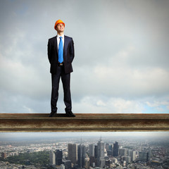 Businessman standing on the construction site