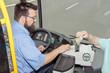 Leinwanddruck Bild - Bus Driver ticket control