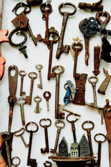Old keys, wall background