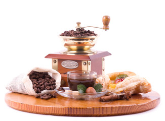 Coffee cup, coffee mill and fruit cake